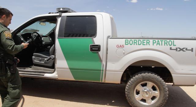 border-patrol-agent-checks-his-phone-LM